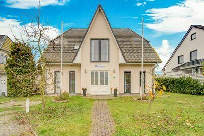 Charmante maison de vacances avec jardin privé à Bastorf