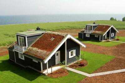 Bungalow individuel moderne avec cheminée, sur mer Baltique