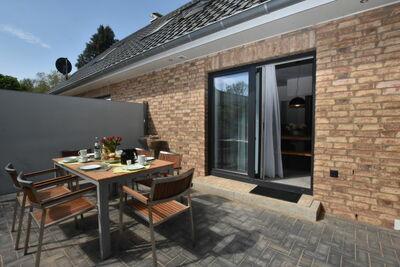 Charmante maison de vacances avec cheminée à Damshagen