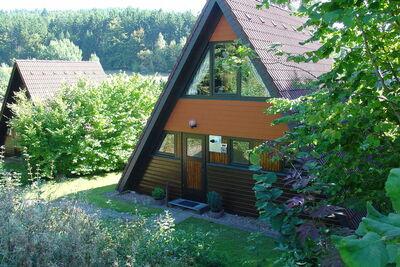 Bungalow individuel bois avec terrasse, dans une zone boisée