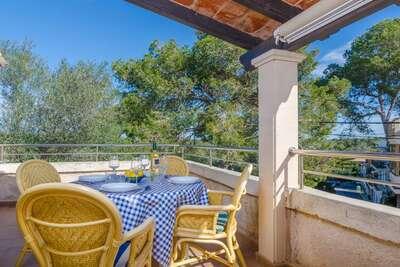 Maison de vacances attrayante à Cala Figuera avec barbecue