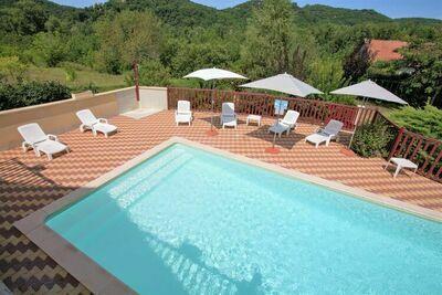 Maison en bord de rivière avec piscine à St-Julien-de-Lampon