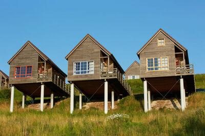 Authentique maison en bois, dans un cadre verdoyant et calme