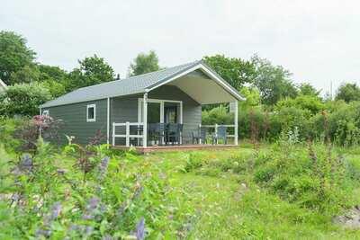 Joli chalet avec terrasse couverte, proche de la mer du Nord