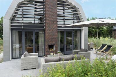 Belle villa neuve avec sauna entourée d'une réserve de dunes près de la mer