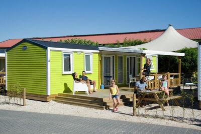 Chalet coloré avec terrasse, proche du lac et de la plage
