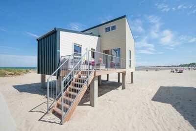Maison de plage unique avec lave-vaisselle et belle vue.