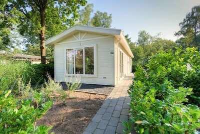Chalet soigné avec jardin et WiFi, près du parc De Veluwe