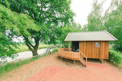 Gîte charmant avec terrasse, au bord de la rivière De Regge