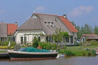 Maison de campagne avec terrasse près de Langweerder Wielen
