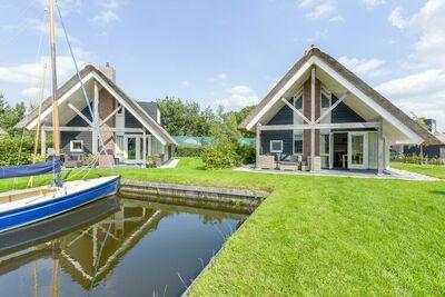 Villa sur l'eau dans la région du Sneekermeer, micro-ondes