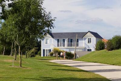 Charmante maison de vacances avec lave-vaisselle sur golf