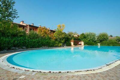 Manoir de luxe avec piscine commune et terrasse couverte