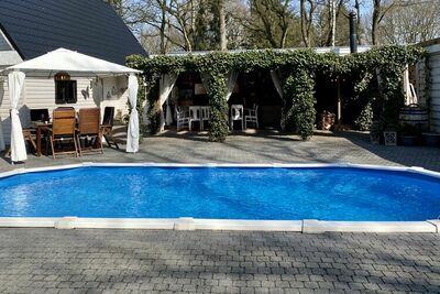 Villa avec piscine privée chauffée et terrasse couverte de style Ibiza avec cheminée extérieure