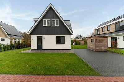 Belle villa avec douche solaire près du Koog sur l'île Wadden de Texel