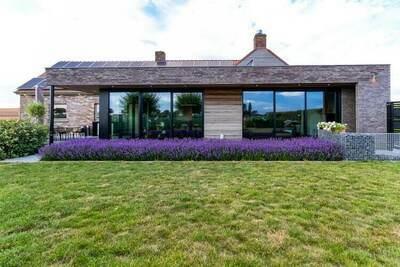 Maison de vacances moderne située à Haringe, parfaite pour des vacances reposantes en famille.