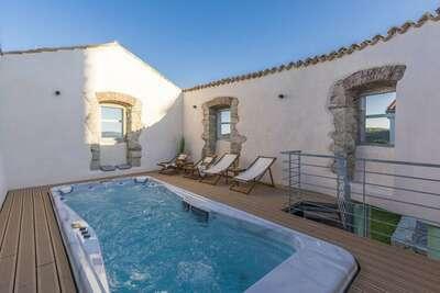 Maison de vacances avec piscine sur le toit, sauna et jardin dans un endroit idyllique