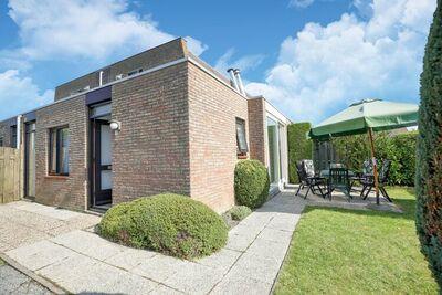 Maison de vacances bien entretenue avec grand jardin, située à Nieuwvliet