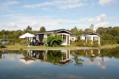 Chalets confortables situés autour de l'étang, dans un petit parc de vacances