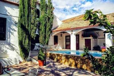 Maison de vacances rurale à Esconar-Illora avec jardin
