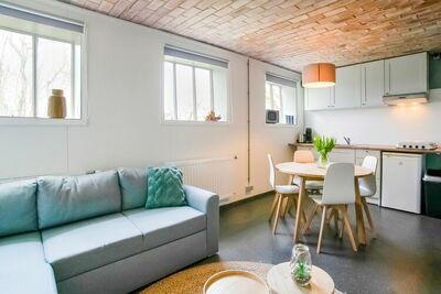 Maison confortable à Sint Maartensvlotbrug avec terrasse commune