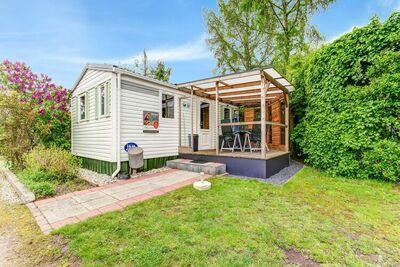 Charmante maison de vacances à Hulshorst avec jardin