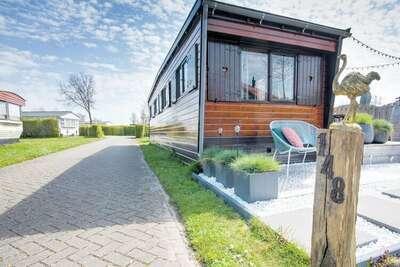 Chalet de style Ibiza avec terrasse lounge à Brouwershaven