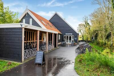 Maison de vacances autonome avec jardin privé et sauna, située à Texel