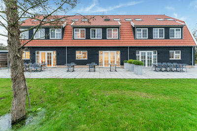 Belle maison de vacances à Den Burg avec piscine partagée